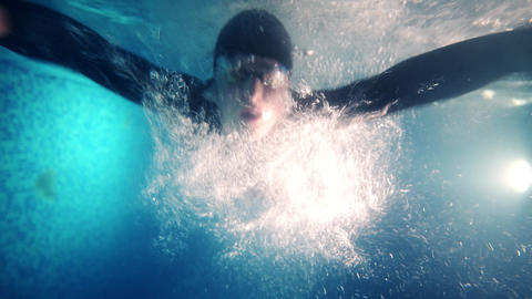 Underwater swim of swimmer in swimming pool. swimming breaststroke training Live Action