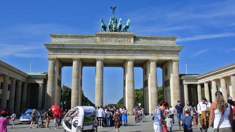 Berlin, Germany. Circa August 2016. Tourists visiting Brandenburg Gate. Zoom in Footage