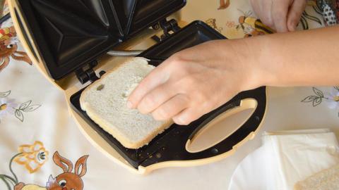 Placing Bread On Sandwich Maker Footage
