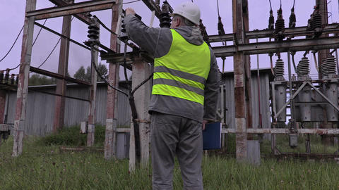 Electrician take picture of high-voltage cable Live Action