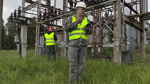 Disappointed electrician using tablet PC in substation Live Action
