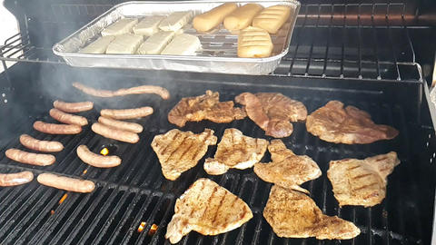 BBQ grilling of steaks, sausages and cheeses Live Action