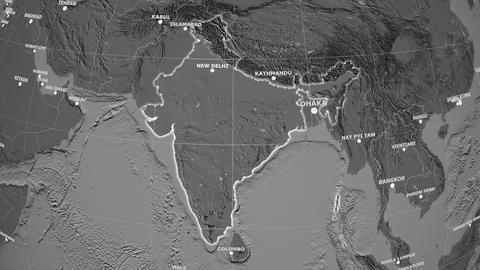 Zoom-in on India outlined. Grayscale contrasted Animation