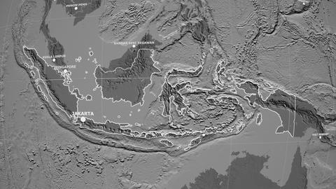 Zoom-in on Indonesia outlined. Grayscale contrasted Animation
