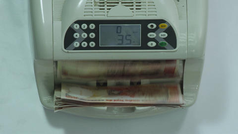 Currency counting machine counting indian money. Banking and commercial activity. Bank automatic Live Action