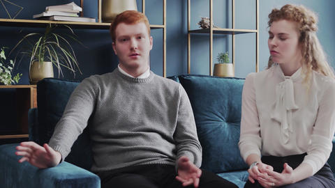 Portrait of unhappy married couple talking to family psychologist. Relationships Live Action