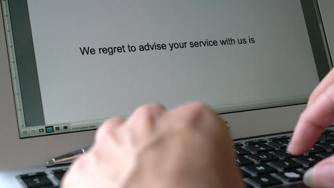 Businesswoman typing a service or job termination letter on the keyboard and the words appear on Live Action