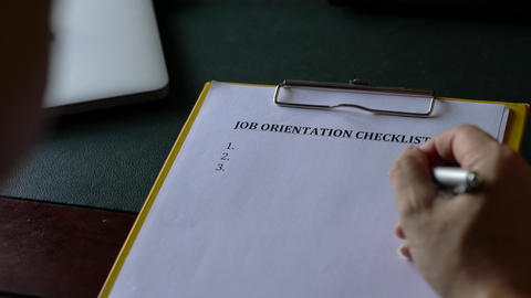 Job orientation checklist, on clipboard Live Action