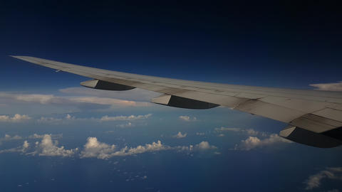 Airplane Wing and Endless Blue Horizon, Flying Above Clouds, Close Up Live Action