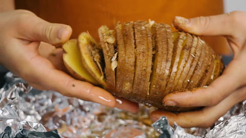 Add spices on big sliced potato. Big sliced potaton in woman's hand Live Action
