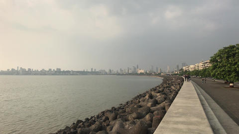 Mumbai, India - November 10, 2019: Marine Drive tourists on the waterfront in Live Action