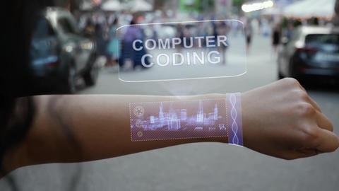 Female hand activates hologram Computer coding Live Action