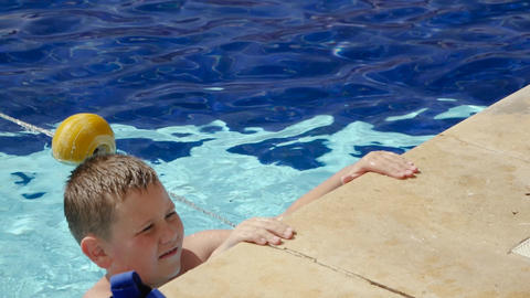 Child in outdoor pool Live Action