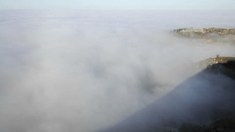 Closeup time lapse of coastal fog at sunrise along the... Stock Video Footage