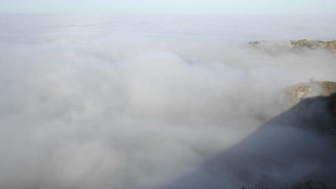Closeup time lapse of coastal fog at sunrise along the Santa Ynez Mountains above Montecito, Califor Footage