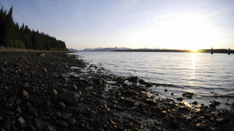 Fast time lapse of the sunset and tide retreating on the beach in Glacier Bay National Park in Gusta Footage