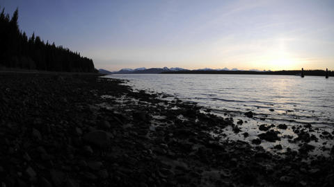Fast time lapse of the sunset and tide retreating on the... Stock Video Footage
