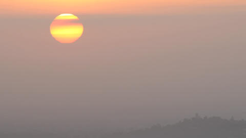 Time lapse of sun rising through the haze from Mount Hollywood in Griffth Park near Hollywood, Calif Footage