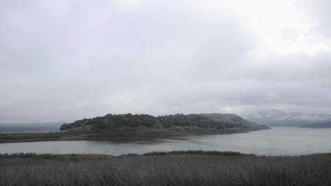 Time lapse of a storm clouds clearing over Lake Casitas in Oak View, California Footage