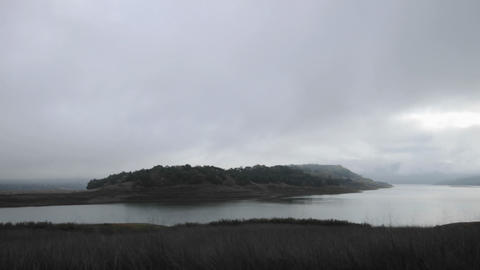 Time lapse of a storm clouds clearing over Lake Casitas... Stock Video Footage