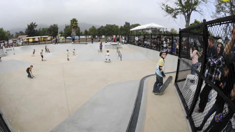 Slow time lapse of skateboarders at the grand opening of Ojai Skate Park in Ojai, California Footage