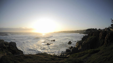 Time lapse of waves and sunrise over Pacific Grove Marine Garden Park in Pacific Grove, California Footage