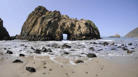 Time lapse of waves breaking through a rock at Pfeiffer Beach in Big Sur, California Footage