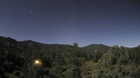 Time lapse motion of startrails and full moon setting... Stock Video Footage
