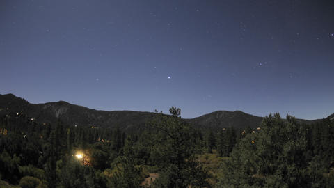 Time lapse motion of startrails and full moon setting over Pine Mountain Club, California Footage