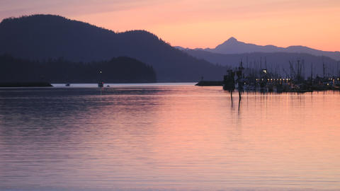 Time lapse of a fishing boat leaving port in Sitka, Alaska Stock Video Footage