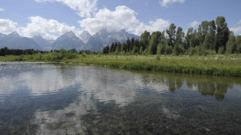 Fast time lapse of clouds at Schwabacher Landing in Grand... Stock Video Footage
