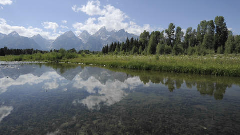 Fast time lapse of clouds at Schwabacher Landing in Grand Teton National Park, Wyoming Footage