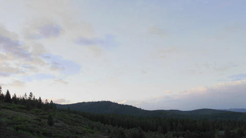 Fast day to night time lapse of clouds and stairtrails in Tahoe National Forest in Truckee, Californ Footage