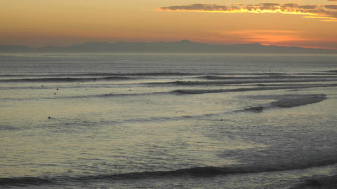 Time lapse close up of surfers and waves at Ventura Point at sunset in Ventura, California Footage
