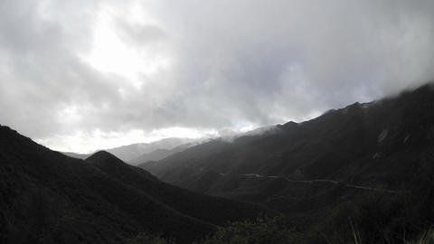 Time lapse motion fast storm clouds clearing over the Santa Ynez Mountains above Ojai, California Footage