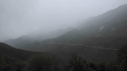 Time lapse of fast rainstorm clearing over the Santa Ynez Mountains above Ojai, California Footage