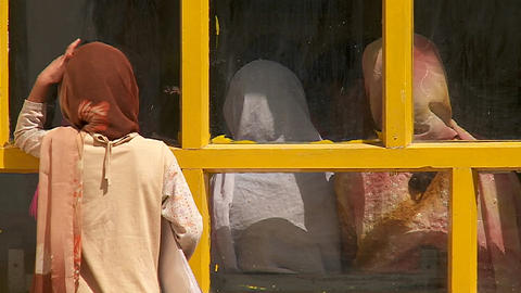 Girls look into a classroom in Kabul, Afghanistan Stock Video Footage