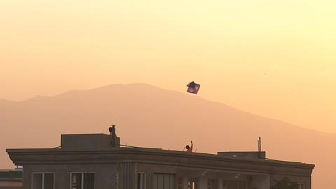 Family flying kites from a rooftop in Kabul, Afghanistan Footage
