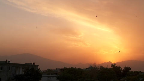 Sunset in Kabul Afghanistan with kites flying Stock Video Footage