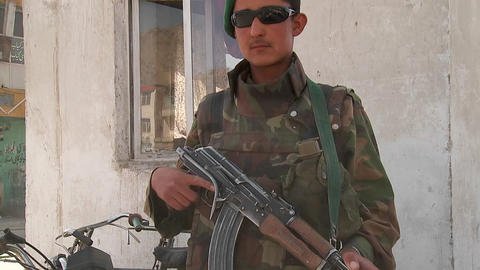 An Afghan National Army soldier fulfills a peacekeeping role in downtown Kabul, Afghanistan Footage