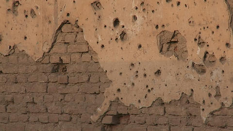 Tilt up of bullet holes in a wall in Kabul, Afghanistan Footage