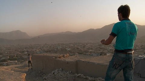 A fierce kite battle on a hill overlooking Kabul,... Stock Video Footage