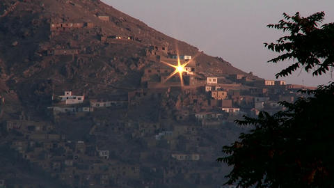 Sun reflects from a hillside window in Kabul, Afghanistan Stock Video Footage