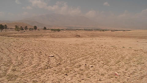 Pan of landmine field to ANA soldier outside Kabul,... Stock Video Footage