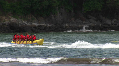 A group of young people wearing red life jackets ride... Stock Video Footage