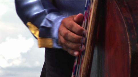 A man plays a guitar in a mariachi band Stock Video Footage