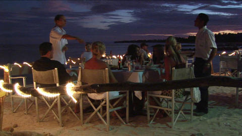 Patrons dine at an outdoor beach restaurant Footage