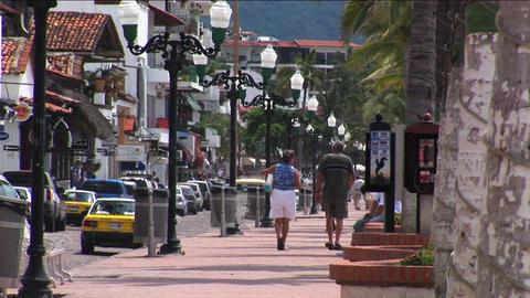 Pedestrians walk on a sidewalk Footage