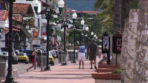 Pedestrians walk on a sidewalk Stock Video Footage