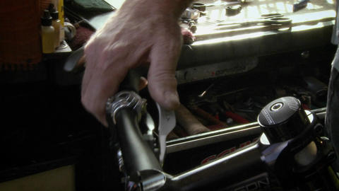 A man is repairing a part on the handlebar of a bicycle Stock Video Footage